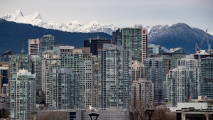 Condo and office towers are seen in downtown Vancouver, with the snow-capped north shore mountains in the distance, on Saturday, Jan. 9, 2021. (Darryl Dyck / THE CANADIAN PRESS)