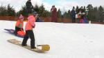 Children sledding on the toboggan hill at the Ferguson Forest Arboretum in Kemptville, Ont. (Nate Vandermeer / CTV News Ottawa)