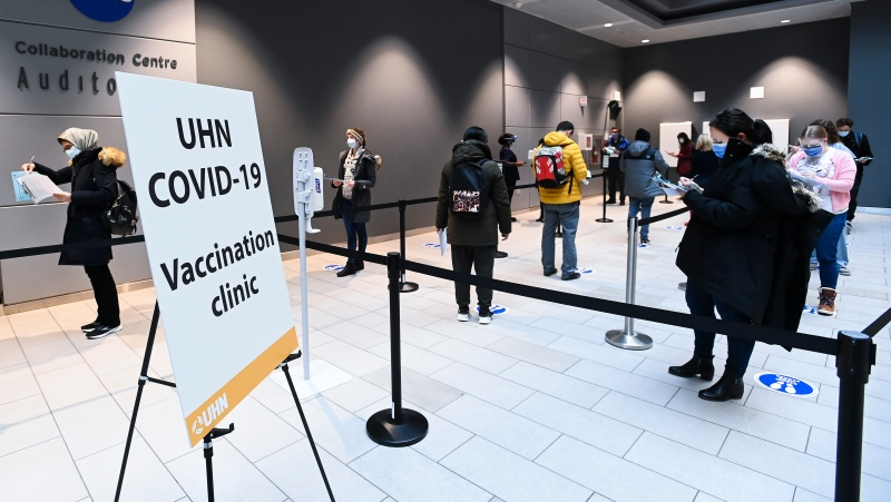 Health-care workers wait in line at a UHN COVID-19 vaccine clinic in Toronto on Thursday, January 7, 2021. (THE CANADIAN PRESS/Nathan Denette)