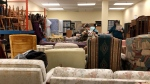 Furniture Bank volunteers selecting donated items for families in need. (Dave Charbonneau / CTV News Ottawa)