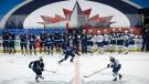 The Winnipeg Jets run drills during their NHL training camp in Winnipeg, Monday, January 11, 2021. (THE CANADIAN PRESS/John Woods)