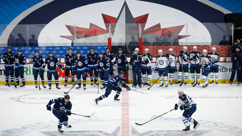 The Winnipeg Jets run drills during their NHL training camp in Winnipeg, Monday, January 11, 2021. (THE CANADIAN PRESS/John Woods)