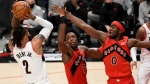 Portland Trail Blazers guard Gary Trent Jr., left, shoots the ball over Toronto Raptors forward OG Anunoby, center, and guard Terence Davis, right, during the second half of an NBA basketball game in Portland, Ore., Monday, Jan. 11, 2021. The Blazers won 112-111. (AP Photo/Steve Dykes)