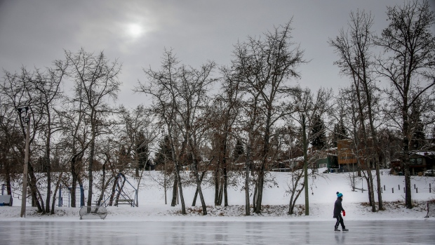 A woman skates on an outdoor rink on a frigid day in Calgary, Alberta, Thursday, Nov. 19, 2020, amid a worldwide COVID-19 pandemic. (Jeff McIntosh / The Canadian Press)