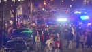 Hundreds of unmasked football fans crowd streets