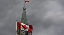 Stormy clouds move in over the Peace Tower on Parliament Hill, Sunday Sept. 13, 2009. (The Canadian Press/Adrian Wyld)