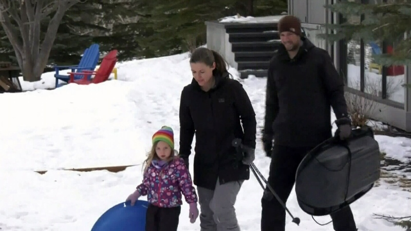Family builds back yard ski hill