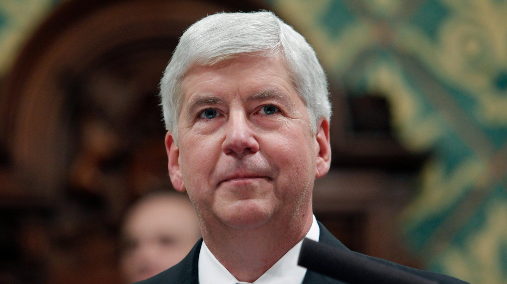 Ex-Michigan governor faces 2 charges in Flint water scandal