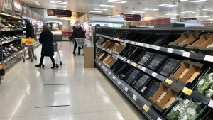 Depleted shelves are seen in a Sainsbury's supermarket at the Forestside shopping centre in Belfast, on Jan. 11, 2021. (David Young / PA via AP)