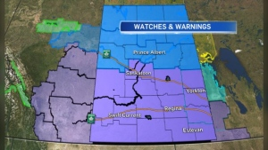 Watches and warnings in effect in Saskatchewan on Jan. 13, as of 3 p.m. A wind warning (purple) is in effect in southern Saskatchewan while a winter storm warning (blue) is in effect throughout the central part of the province.