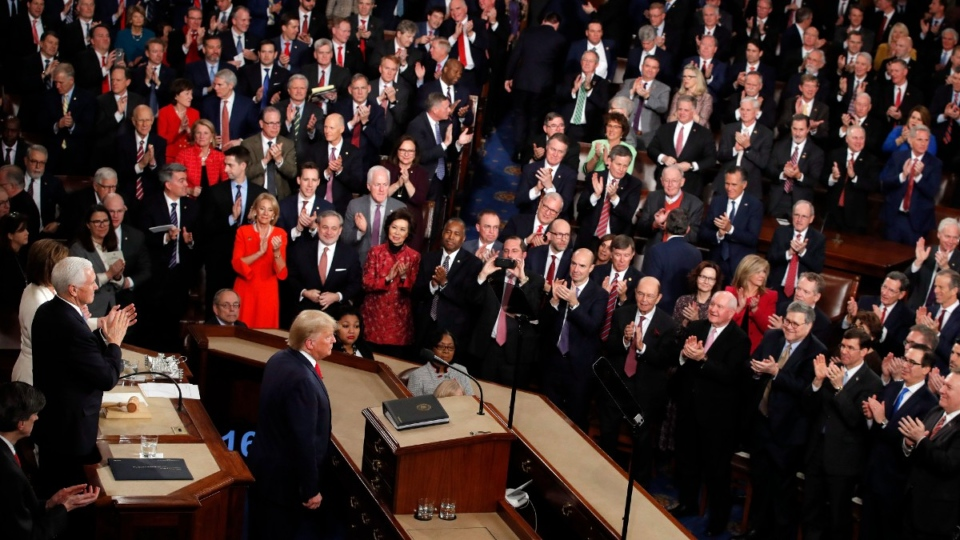 Trump stands as he finished his State of the Union