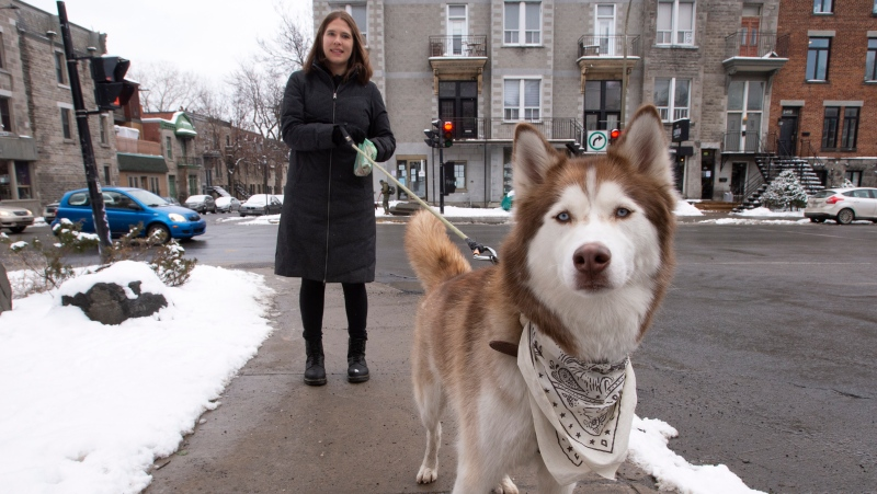 Ita Skoblinski walks her dog Waylon, Tuesday, January 12, 2021 in Montreal. Skoblinski adopted her dog during the pandemic and posted a joking offer online to let people walk her dog after curfew and got tons of answers.THE CANADIAN PRESS/Ryan Remiorz