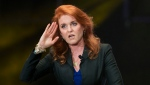 "In this Monday, March 7, 2016 file photo, Sarah Ferguson, Duchess of York, salutes during a press event, in Mexico City. Ferguson has landed a book deal for her debut novel for adults, a historical romance fictionalizing the life and loves of her great-great-great aunt. In a promotional video posted on her Twitter account Wednesday, Jan. 13, 2021 the former Sarah Ferguson said the novel is set in the Victorian era and is ""about daring to follow your heart against the odds."" (AP Photo/Rebecca Blackwell, file)"