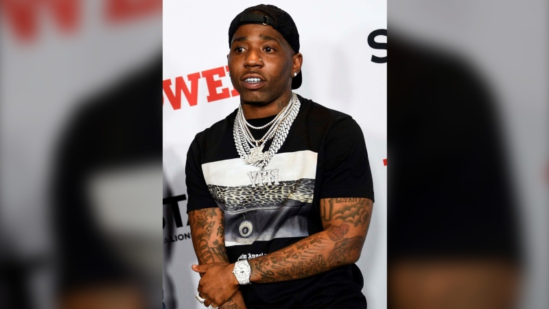 "In this Aug. 20, 2019 file photo, rapper YFN Lucci, whose real name is Rayshawn Bennett, attends the world premiere of the final season of Starz TV's ""Power"" in New York. Police said Tuesday, Jan. 12, 2021, they are searching for Bennett, who is wanted on murder and other charges following a fatal shooting last month in Atlanta. (Photo by Evan Agostini/Invision/AP, File)"