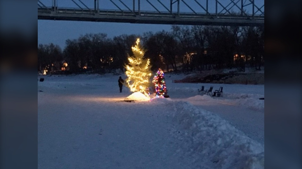 A Christmas tree is lit up on the Assiniboine River (CTV News Photo Rachel CrowspreadingWings)