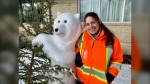 Vinora Bennett of St. Vital poses with her favourite polar bear sculpture, one of 13 she's created in her Barrington Ave. front yard (Photo: Scott Andersson/CTV News)