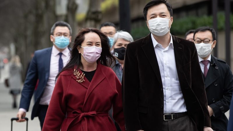 Meng Wanzhou, chief financial officer of Huawei, leaves B.C. Supreme Court with her husband Liu Xiaozong, during a break from a hearing in Vancouver, on Thursday, December 10, 2020. THE CANADIAN PRESS/Darryl Dyck