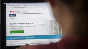 A person looks at a Canada Revenue Agency homepage in Montreal, Sunday, August 16, 2020, as the COVID-19 pandemic continues in Canada and around the world. (THE CANADIAN PRESS/Graham Hughes)