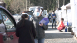 A line of vehicles stretched the entire length of the Cowichan Tribes band office parking lot Wednesday morning as members signed in for their first chance at a COVID-19 vaccine. (CTV)