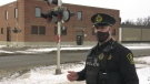 Cst. Hank Neumiller with the CN Railway Police is pictured at the Broadway St. rail crossing in Yorkton. (Kaylyn Whibbs / CTV NEWS)