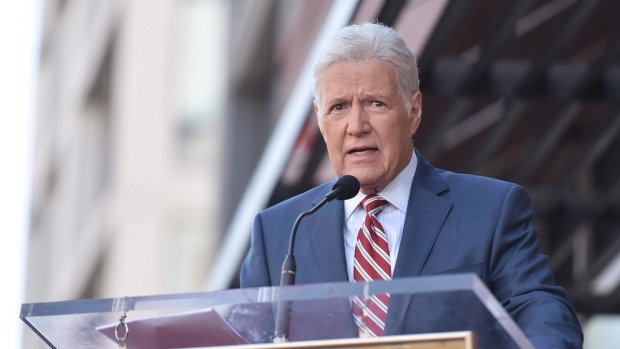 """Alex Trebek speaks at a ceremony honouring Harry Friedman, executive producer of """"Wheel of Fortune"""" and """"Jeopardy!"""" with a star on the Hollywood Walk of Fame on Friday, Nov. 1, 2019, in Los Angeles. THE CANADIAN PRESS/Photo by Richard Shotwell/Invision/AP)"""