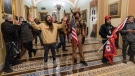 In this Wednesday, Jan. 6, 2021 file photo, supporters of U.S. President Donald Trump are confronted by U.S. Capitol Police officers outside the Senate Chamber inside the Capitol in Washington. (AP Photo/Manuel Balce Ceneta)