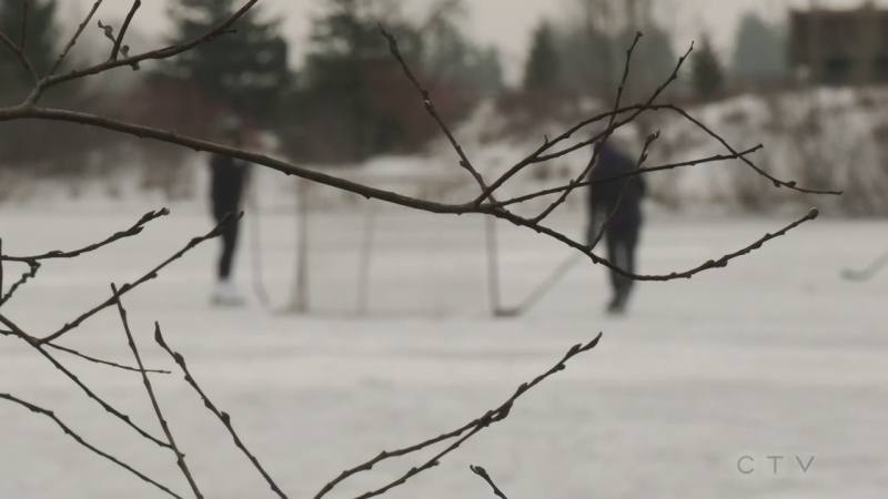 Two playing hockey on a London Ontario rink Jan 13 2021 (Marek Sutherland / CTV News)