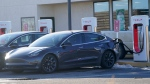 Motorists charge their vehicles at a Tesla supercharging location next to a fast-food restaurant off Interstate 70 Wednesday, Dec. 30, 2020, in Limon, Colo. (AP Photo/David Zalubowski)