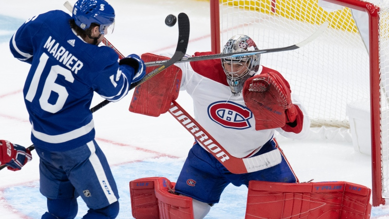 Montreal Canadiens goaltender Carey Price (31) and Toronto Maple Leafs centre Mitch Marner (16) battle for the puck during second period NHL hockey action in Toronto, Wednesday, Jan. 13, 2021. THE CANADIAN PRESS/Frank Gunn