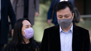 Meng Wanzhou, chief financial officer of Huawei, leaves B.C. Supreme Court with her husband Liu Xiaozong, during a break from a hearing in Vancouver, Wednesday, January 13, 2021. Meng, who is free on bail while fighting extradition to the U.S., is seeking to have the terms of her release conditions changed.THE CANADIAN PRESS/Jonathan Hayward
