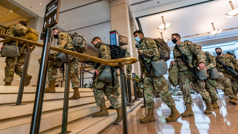 Members of the National Guard gather at the Capitol Visitor Center, Wednesday, Jan. 13, 2021, in Washington as the House of Representatives continues with its fast-moving House vote to impeach President Donald Trump, a week after a mob of Trump supporters stormed the U.S. Capitol. (AP / Manuel Balce Ceneta)