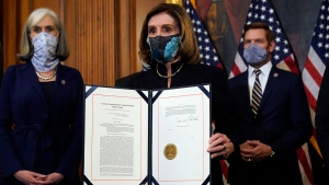 House Speaker Nancy Pelosi of Calif., displays the signed article of impeachment against President Donald Trump in an engrossment ceremony before transmission to the Senate for trial on Capitol Hill, in Washington, Wednesday, Jan. 13, 2021. (AP / Alex Brandon)