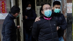 District councillor and lawyer Daniel Wong Kwok-tung, centre, is escorted by police outside his office after police search in Hong Kong, Thursday, Jan. 14, 2021. (AP Photo/Vincent Yu)