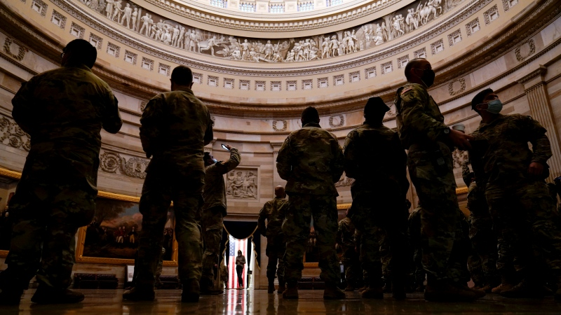 Troops stand in the Capitol Rotunda as they reinforce security at the Capitol in Washington, Wednesday, Jan. 13, 2021. (AP Photo/Susan Walsh)