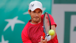 Britain's Andy Murray plays a shot against Switzerland's Stan Wawrinka in the first round match of the French Open tennis tournament at the Roland Garros stadium in Paris, France, Sunday, Sept. 27, 2020. (AP Photo/Christophe Ena)