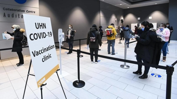 Health-care workers wait in line at a UHN COVID-19 vaccine clinic in Toronto on Thursday, January 7, 2021. THE CANADIAN PRESS/Nathan Denette