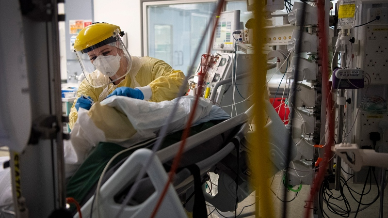 A U.K. study suggests COVID-19 infection grants immunity for five months. Seen here, a nurse works with a patient inside the Intensive Care Unit at St. George's Hospital in London, on January 6. (Victoria Jones/AP)