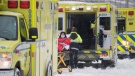 Paramedics transfer a person from an ambulance into a hospital in Montreal, Saturday, January 2, 2021. THE CANADIAN PRESS/Graham Hughes