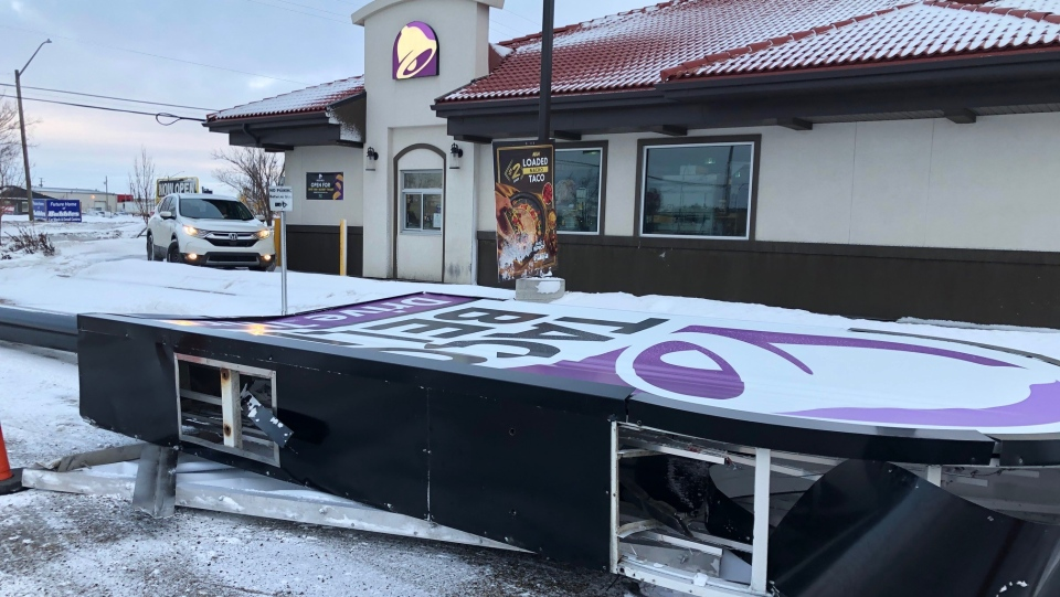 A sign at a Millar Avenue business was blown over during a winter storm that hit the city on Jan 13, 2021. (Chad Hills/CTV News)