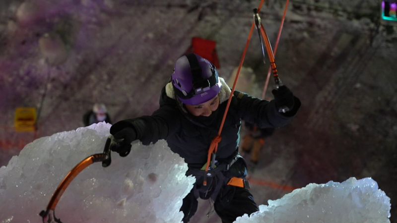 Kim Wynn climbs the ice wall