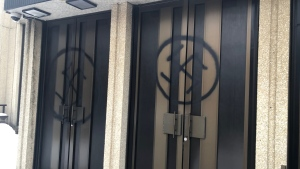 Spray-painted swastikas are shown on the doors of Shaar Hashomayim, one of Montreal's largest synagogues in a handout photo. Montreal police say a 28-year-old man arrested Wednesday for allegedly defacing a synagogue with anti-Semitic graffiti will appear in court today. THE CANADIAN PRESS/HO