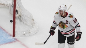 Chicago Blackhawks' Jonathan Toews (19) celebrates a goal during first period NHL playoff action against the Edmonton Oilers, in Edmonton, Saturday, Aug. 1, 2020. THE CANADIAN PRESS/Jason Franson