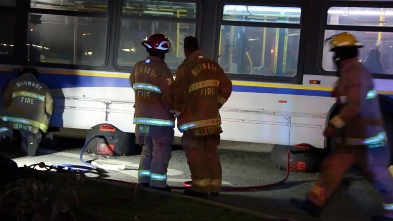 Pedestrian pinned under transit bus