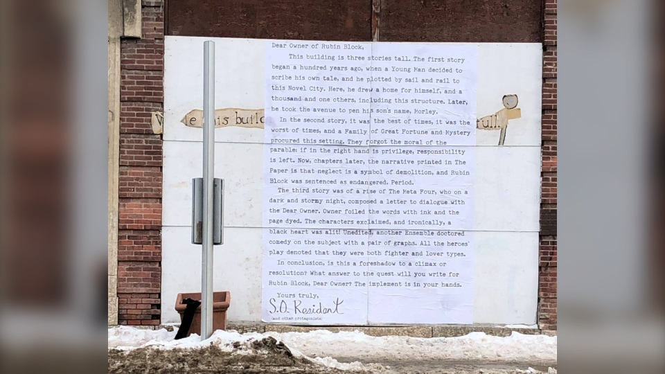 An anonymous South Osborne resident plasters a letter to the side of the Rubin Block. (Supplied: Oriana Marinelli/Rubin Block Advocates)