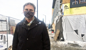Leo Therrien, executive director of Place des Arts, said wearing masks, construction workers are completing work inside and outside the Place des Arts in downtown Sudbury. The workers are excluded from the provincial stay-at-home order. (Alana Everson/CTV News)