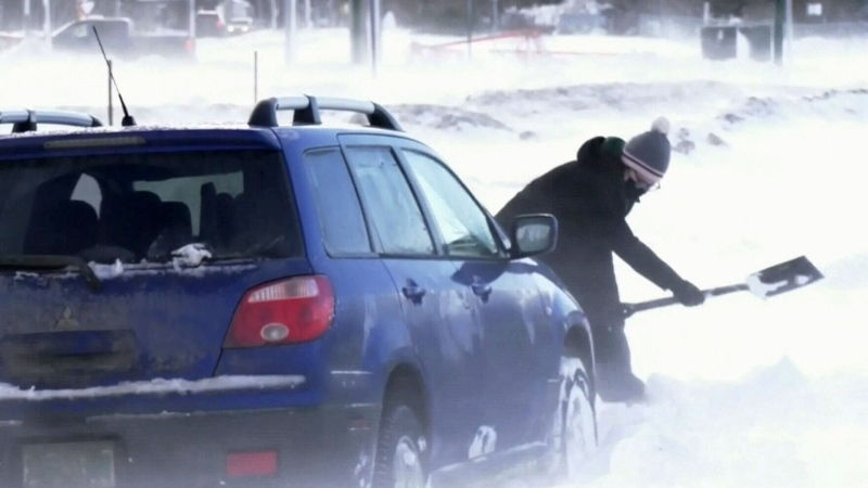 A person shovels snow in Saskatoon in this file photo.