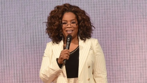 """Oprah Winfrey makes opening remarks during """"Oprah's 2020 Vision"""" tour on Feb. 29, 2020, in Inglewood, Calif. (Photo by Richard Shotwell/Invision/AP)"""