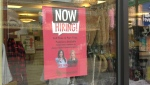 A 'Now Hiring' sign is posted outside of Heirloom Linens in Broadmead Village: (CTV News)