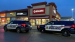 Officers respond to an armed robbery at a Cambridge business (Terry Kelly / CTV News Kitchener)