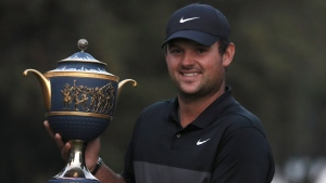 Patrick Reed of the United States poses with the trophy after winning the WGC-Mexico Championship golf tournament, at the Chapultepec Golf Club in Mexico City, Sunday, Feb. 23, 2020. (AP Photo/Fernando Llano)